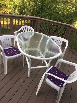 $150 white Patio deck glass table and four chairs 55L x 29 tall by 38 wide for Sale in Rochester Hills, MI