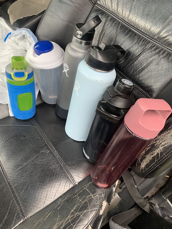 Used Hydro flask water bottle and camelbak water bottle bubba waterbottle and container with sauce cup and fork and regular water bottle everything