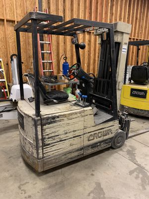 2 crown and 1 Nissan forklift and two chargers. for Sale in Denver, CO