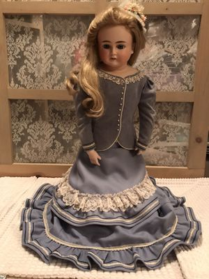 Antique bisque doll with beautiful blue dress and long blonde hair for Sale in Orlando, FL