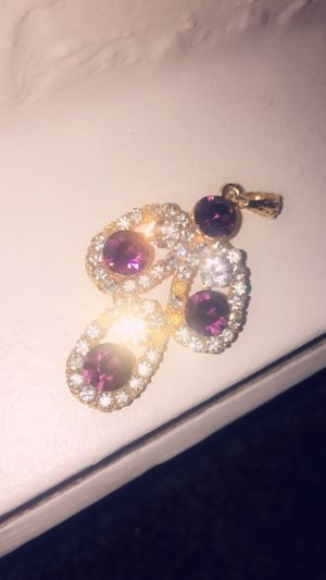 Gold charm with purple gems for Sale in Lawton, OK