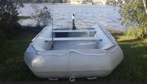 LIKE NEW ! !! 11-feet SD330W EXTRA WIDE inflatable boat 🚣♀️ Ideal for 4 people! Includes Minn Kota Riptide 45 hp trolling motor for salt or fresh w for Sale in Orlando, FL