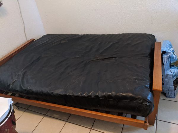 Used wood and fake leather futon