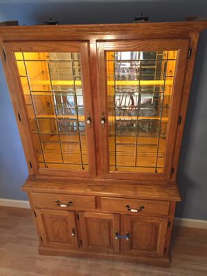 Two piece china hutch with beveled glass doors for Sale in VLG WELLINGTN, FL