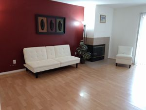 Complete white leather living room futon leather white + 3 storage leather chairs for Sale in Corona, CA