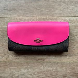 COACH Signature coated canvas envelope wallet in Bright Fuchsia Pink for Sale in Fullerton, CA