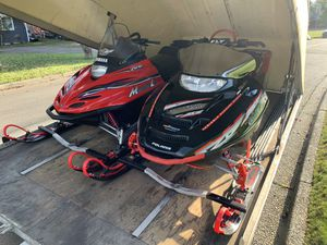 Snowmobile and Trailer. 2003 Polaris RMK Vertical Escape 800, 2001 Yamaha Mountain Light 500. 2000 covered drive on/off trailer for Sale in Renton, WA