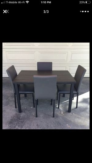 Dark grey and brown table with 4 chairs for Sale in Escondido, CA