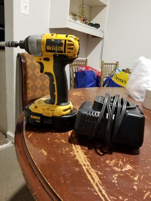 I am selling this drill dewalt impact 18 volts with battery and charger in perfect condition only serious people please for Sale in Manassas, VA