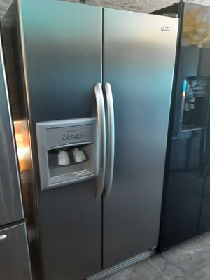 $450 Kenmore stainless side-by-side fridge includes delivering the San Fernando Valley a warranty and installation for Sale in Los Angeles, CA
