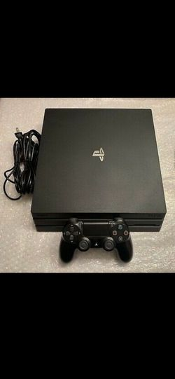 Playstation 4 Pro (1TB) + 2 Games for Sale in New York,  NY
