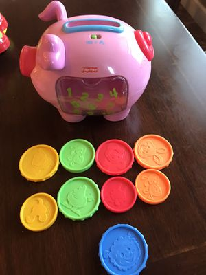 Fisher price piggy bank coins new batteries for Sale in Clovis, CA
