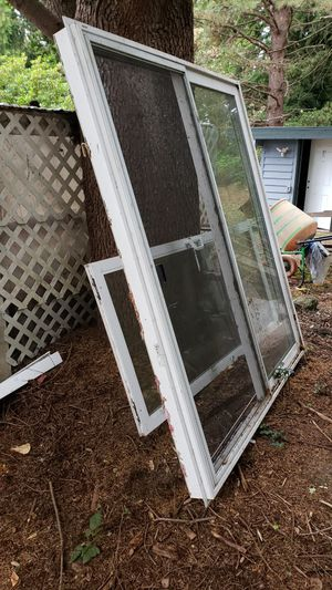 "Sliding glass door, 6 feet (72"")wide ,80 in high. White . opens from right to left from inside.. slight water damage. was left out side accidentally for Sale in Federal Way, WA"