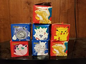 12 pokeballs. 7 gold cards 1 pokemon watch 2 misc items. 45 trading cards for Sale in Warren, MI