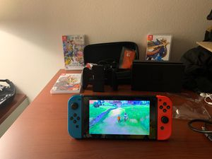 Nintendo switch with controllers and 3 games and case for Sale in Louisville, KY