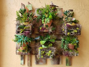 Succulent wall arrangement. One of a kind home made arrangement for your patio or front porch. Artificial plants. for Sale in Miami, FL
