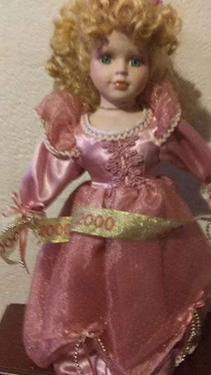 Porcelain doll pink dress has the year 2000 on it very good condition for Sale in Kings Mountain, NC