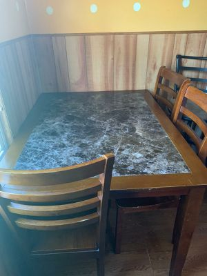Table and 4 chairs wood good condition for Sale in Melvindale, MI