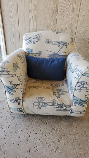 Kids rocking chair with vintage airplane design. Just needs cleaning for Sale in Riverside, CA
