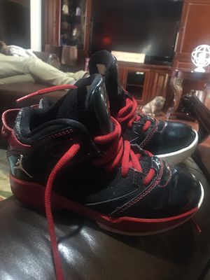 Jordan red and Black kids size 11c for Sale in Winona, TX