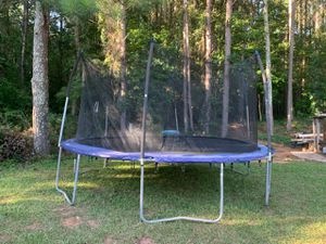 15 foot large trampoline in good condition price $ 200 cash only [already disassembled ready to ride] for Sale in Snellville, GA