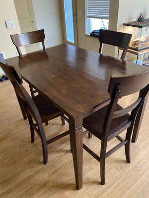 High Wood Kitchen table with 4 chairs. Extendable leaf folds into table for convenient storage. for Sale in East Wenatchee, WA