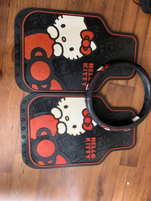 Hello kitty car mats x2 and steering wheel cover for Sale in McDonough, GA