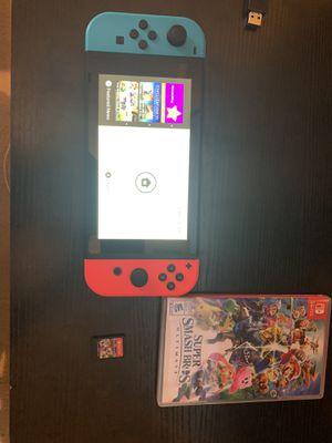 Nintendo switch w/ Mario Kart and Super Smash bro's for Sale in Parkland, FL