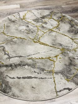 Round Marble Look Gold And Grey Carpet for Sale in Orlando,  FL