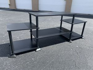 Modern black light weight living room bedroom entertainment center storage shelving! Very sturdy. See last pic for slight damage but doesn't affect s for Sale in West Palm Beach, FL