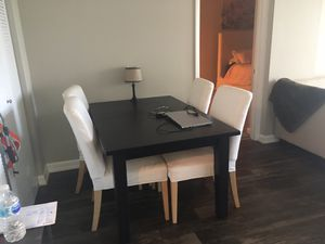 Dark brown expandable dining room set with beige/off white chairs for Sale in Miami, FL