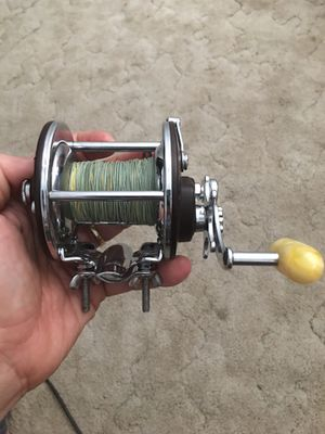 Penn 209 fishing reel with the heavy duty pole mounting bracket ( they use on most deep sea fishing poles) for Sale in Turlock, CA