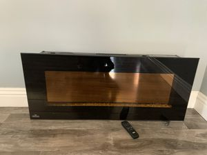Electric fireplace with controller and extra rocks for Sale in Pasadena, CA