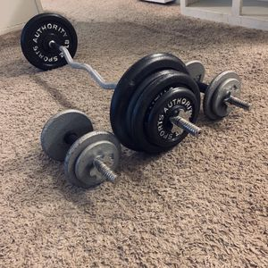 curling bar dumbbell Bars In excellent condition 140 pounds in total for Sale in Ontario, CA