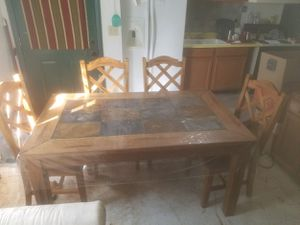 Oak hard wood table and cushioned chairs with a faux leather. for Sale in Payson, AZ