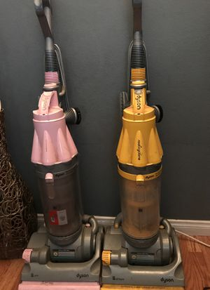Two Dyson vacuums all they need is the band ...best offer for Sale in Downey, CA