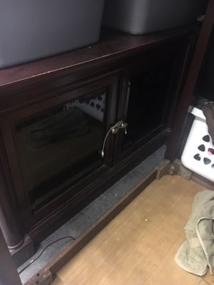 Cherry wood tv stand glass doors selves big enough for 60 inch tv $150 OBO for Sale in Tampa, FL