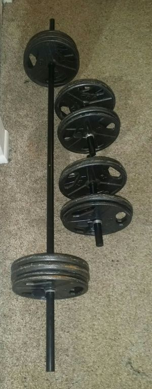 Weights metal 120lbs. 8x10lbs, 8x5lbs, 5 foot straight bar and 2 dumbbell bars. 6 weight lock clips. for Sale in Deerfield Beach, FL