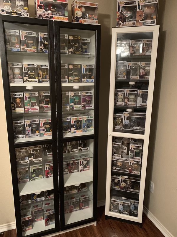 IKEA Billy bookcase w/glass doors, LED lights and wood and glass shelves.