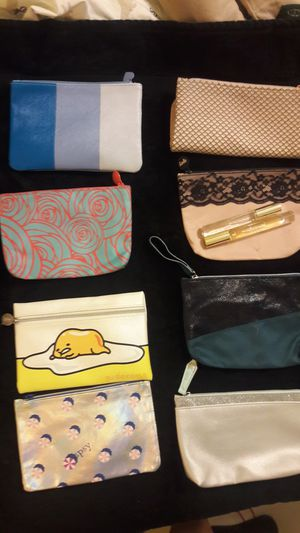 LOT OF 8 IPSY BAGS AND 2 ROLLER BALL PERFUME Shania & Lovely Sarah Jessica Parker for Sale in Plantation, FL