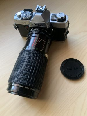 Minolta XG-7, 35mm film camera with Sigma zoom lens and lens cap for Sale in Glendale, CA