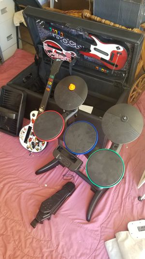 Guitar hero set, 3 guitars, drum sticks, and drum set with pedal, and storage ottoman bench for Sale in Winter Park, FL