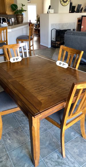 Adjustable Dining table and 6 matching chair set for Sale in Bakersfield, CA