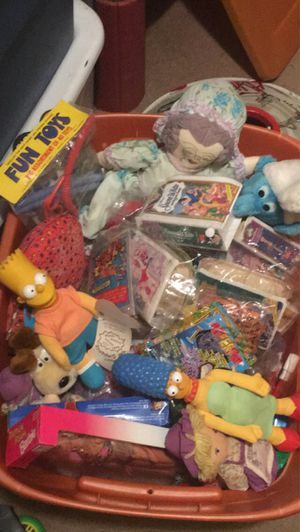 Bin filled with happy meal toys from the 90s and 2000, along with some other dolls and stuffed animals. for Sale in Toms River, NJ