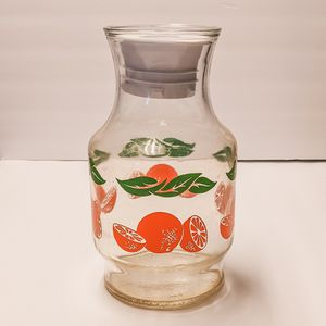 Glass orange pitcher for Sale in Chandler, AZ