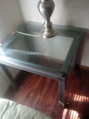 Dark Gray mental end Tables glass top lol yellow polish on top on 2nd end table remover will come off for Sale in Columbus, OH