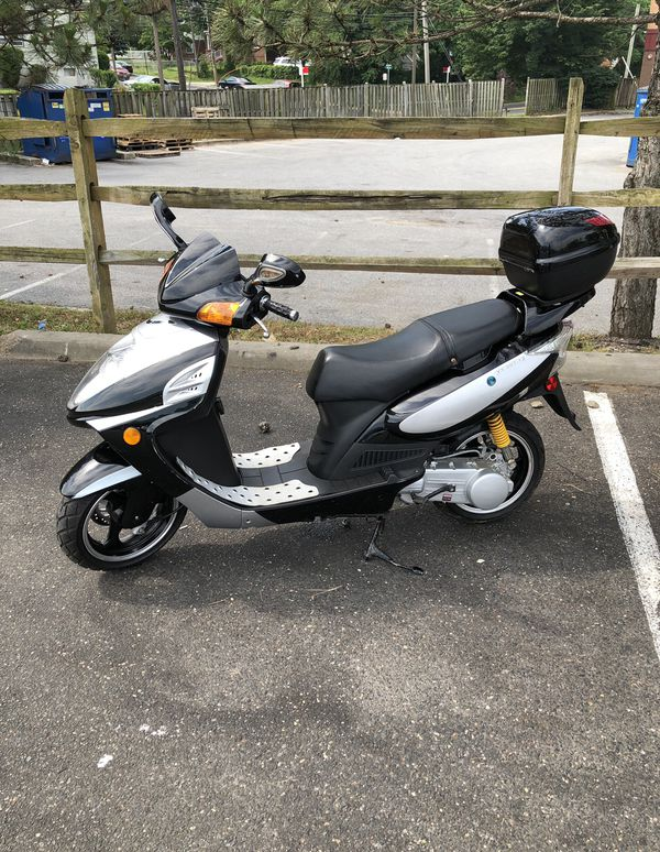 150cc Jonway Motor Scooter 421 lbs. Only 60 miles used!!! Absolutely no technical or electrical issues. The helmet ($120) battery charger ($55), and