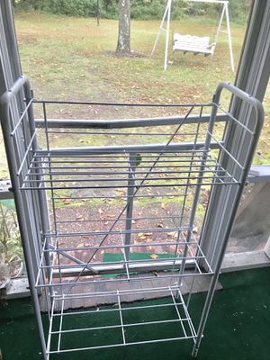 Two White Solid Stands with four shelve s for Sale in Wilson, NC