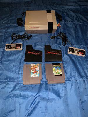 Nintendo with Super Mario Bros 2 and Teenage Mutant Ninja Turtles for Sale in Houston, TX