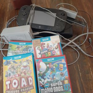 Nintendo wii u black with gamepad and 4 games mario kart super world toad all cables working great for Sale in San Bernardino, CA